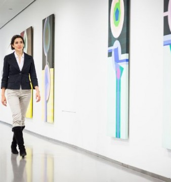 Lady walking corridor art gallery exhibition